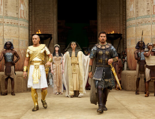 DF-00727R - Seti (John Turturro, background) presents the future leaders of Egypt: Ramses (Joel Edgerton, left) and Moses (Christian Bale).